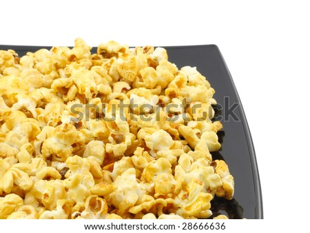 Fragment of plate with fresh caramel popcorn. Close-Up. Isolated - stock photo