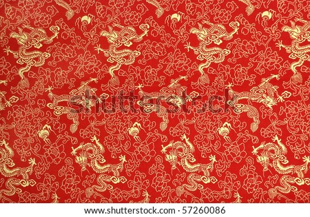 Fragment of red chinese silk with golden dragons and flowers - stock photo