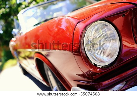 Fragment of red retro car - stock photo