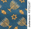 Fragment of retro Jewish synagogue tapestry textile pattern with Hanukkah ornament as background - stock photo