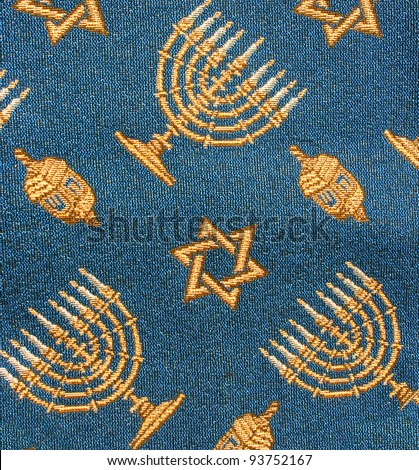 Fragment of retro Jewish synagogue tapestry textile pattern with Hanukkah ornament as background