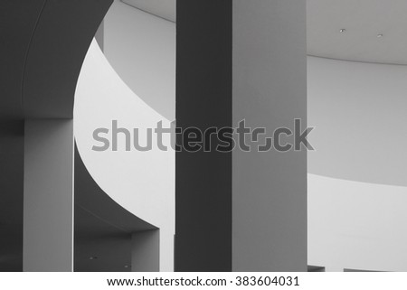 Fragment of rotunda / round room / hall. Refined photo of abstract contemporary architecture in soft shades of black and white palette. - stock photo