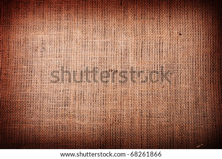 Fragment of rough brown textile background