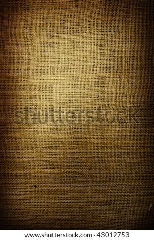 Fragment of rough green textile background