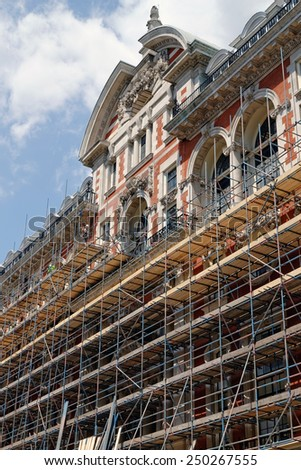 Fragment of scaffolding against house wall in Central London - stock photo
