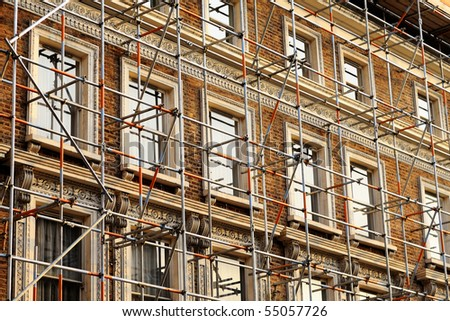 Fragment of scaffolding against house wall in West London - stock photo