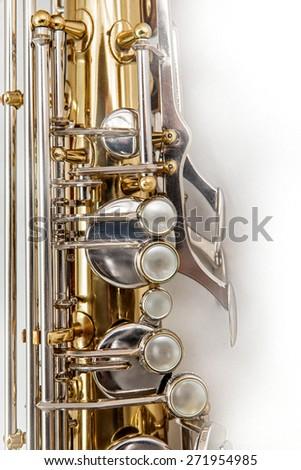 Fragment of Tenor Saxophone on white background. Tenor sax close up. Close up of keys tenor saxophone. Wonderful instrument. For left hand. - stock photo