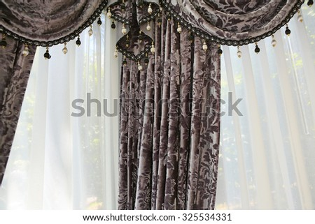 fragment of the beautifully decorated curtains - stock photo