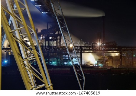 Fragment of the crane and steel foundry - stock photo