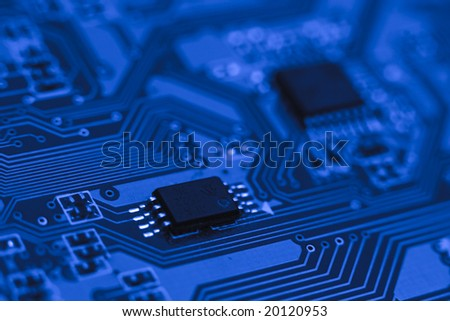 Fragment of the electronic circuit - blue computer board with chips and components