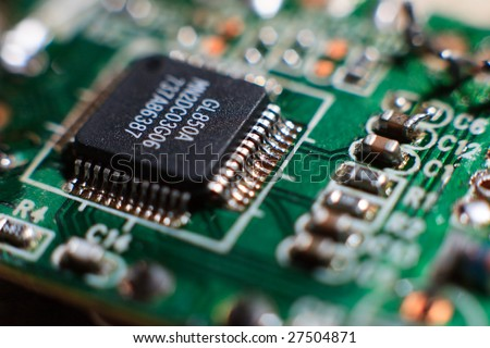 Fragment of the electronic circuit - computer board with chips and components