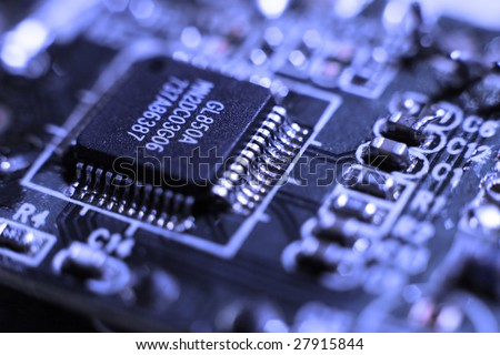 Fragment of the electronic circuit - computer board with chips and components - stock photo