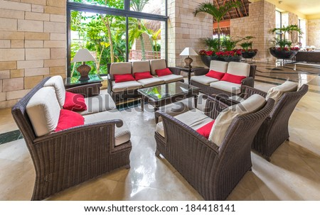 Fragment of the lobby, lounge area with some chairs and table of five stars luxury caribbean resort hotel. Interior design. Bahia Principe, Riviera Maya, Mexico. - stock photo