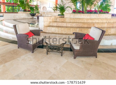 Fragment of the lobby with some chairs and table of five stars luxury caribbean resort hotel. Lounge area. Interior design. Bahia Principe, Riviera Maya, Mexico.
