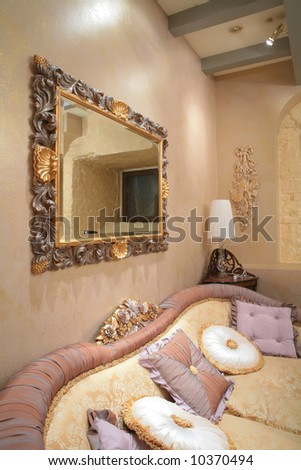 fragment of the luxurious interior of sitting room with sofa - stock photo