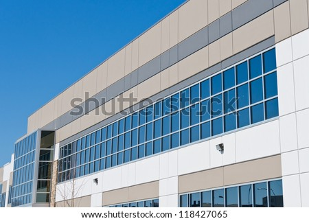 Fragment of the office buildings with modern corporate architecture. Facade with windows.