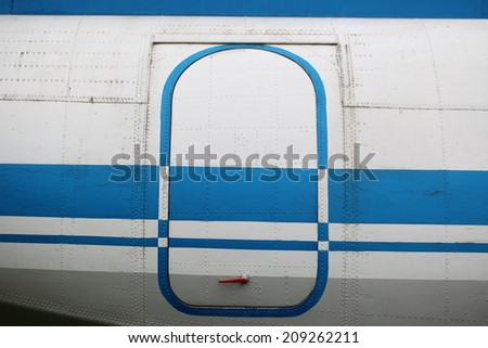 fragment of the old Soviet aircraft. horizontal shot - stock photo