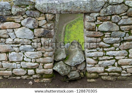 Fragment of the old wall of the Machu Picchu Ruins - stock photo