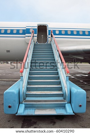 Fragment of the plane and ladder in airdrome - stock photo