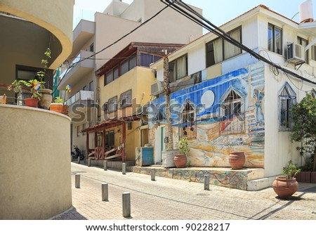 Fragment of the restored street in old residential area of Tel-Aviv - stock photo