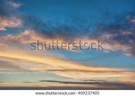 Fragment of the sky with clouds at sunset - stock photo