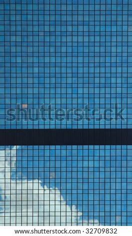Fragment of the skyscraper over sky background
