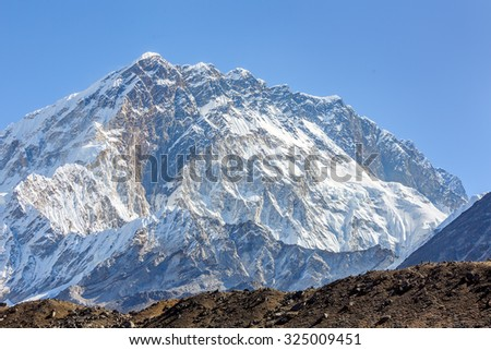 Fragment of the snow ridge in the massif of wall Nuptse from Lobuche village - Everest region, Nepal, Himalayas - stock photo