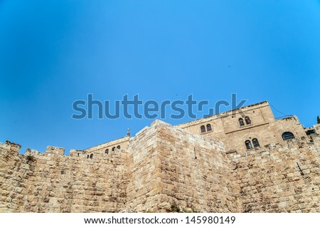 Fragment of the wall surrounding the Old City of Jerusalem - stock photo