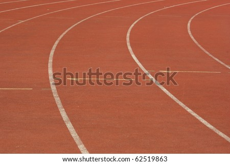 fragment of track on athletic stadium - stock photo