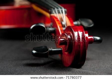 fragment of violin on dark velvet background - stock photo