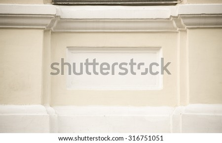Fragment of yellow plastering wall with white pattern. Toned. - stock photo