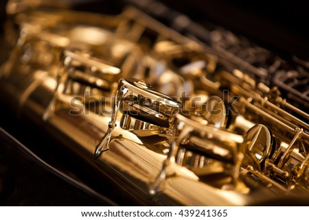 Fragment valves saxophone closeup - stock photo