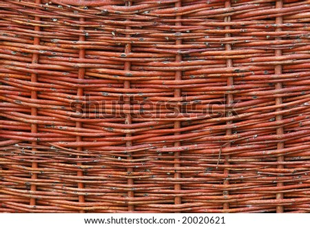 fragment wicker a fence, the sample of handmade from vegetative raw material - stock photo