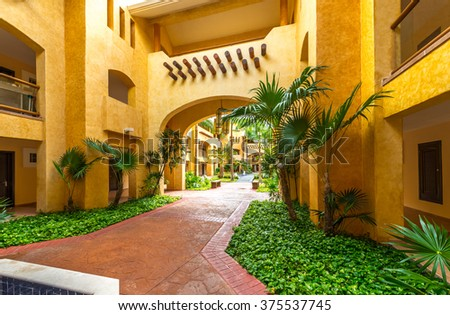 Fragment with the arch of urban architecture of caribbean, tropical style gallery, building, hotel. - stock photo