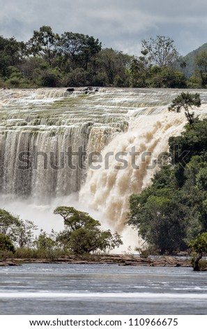 Fragmental view of the Hacha waterfall in the lagoon of Canaima national park before the storm - Venezuela