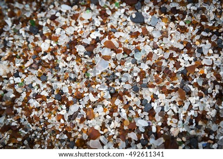 Fragments of glass intermixed with lava rock and sand at Glass Beach on the island of Kauai, Hawaii