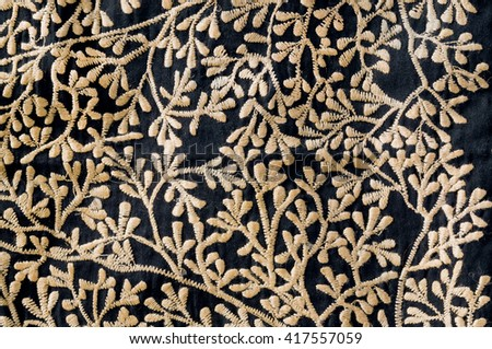 Fragments of old handmade blanket from India. Floral patterned embroidery on vintage background of patchwork tradition.  - stock photo