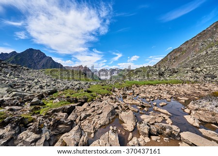 Fragments of rocks in water. Hanging Valley in the alpine tundra of eastern Siberia . Russia - stock photo