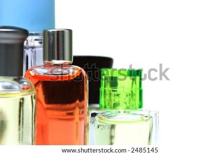 Fragrance bottles against a white background - stock photo
