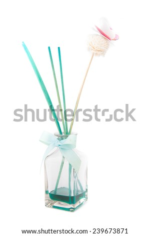 Fragrance diffuser with paper butterfly over white background - stock photo