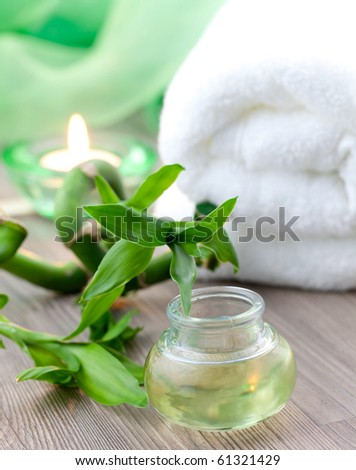fragrance oil with bamboo, candle and towel - stock photo