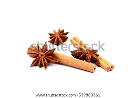 Fragrant anise and cinnamon isolated on white background