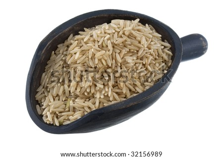 fragrant basmati brown rice on a rustic wooden scoop, isolated on white - stock photo