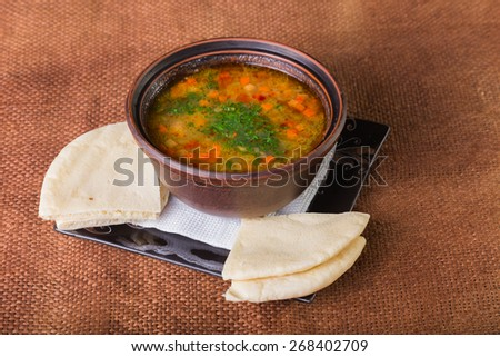 Fragrant, delicious soup in a bowl. - stock photo