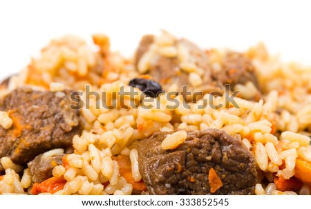 Fragrant pilaf with lamb meat and dried apricots. Macro. Photo can be used as a whole background. - stock photo