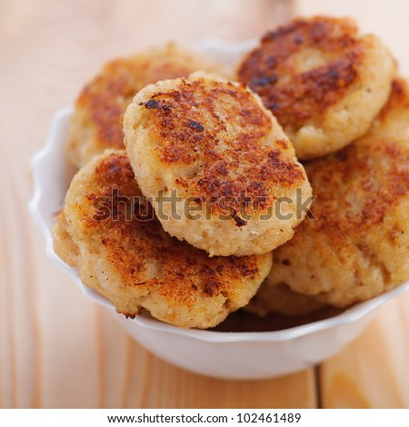 fragrant, ruddy meat patties(pork, beef, lamb) close-up in bowl on wooden background - stock photo