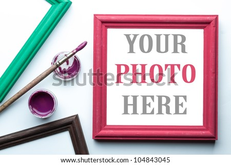 Frame, acrylic paint and paint brush. Places for your photo or text. - stock photo