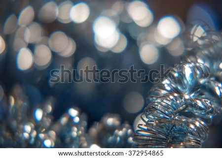 Frame background for text in gray color. Defocused lights and decoration on foreground selective focus. Shallow DOF. - stock photo