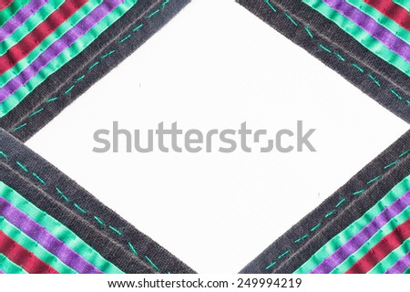 Frame border of fabric texture on a white background - stock photo