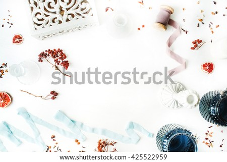 frame decorated with candlesticks, blue ribbon, dry oranges and rowan branches isolated on white background. flat lay, overhead view - stock photo